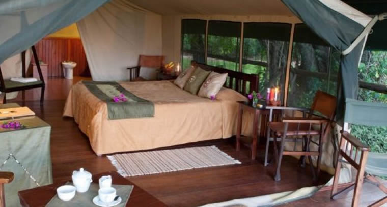 sabyinyo-silverback-lodge-interior-bed